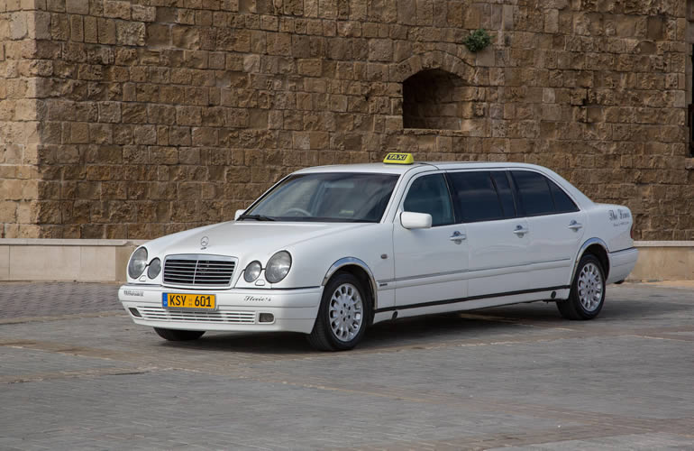 our fleet white taxi